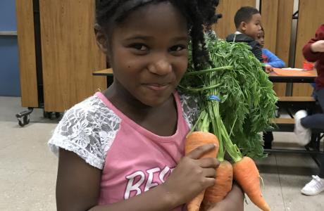 Student with carrots